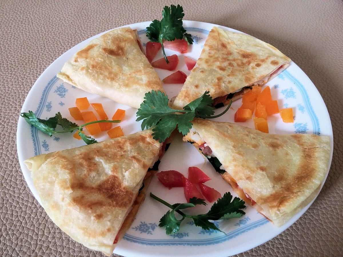 Use flour or corn tortillas, stuff them with whatever you like, and cook for 2 to 4 minutes in a quesadilla maker. Don't forget the cheese!