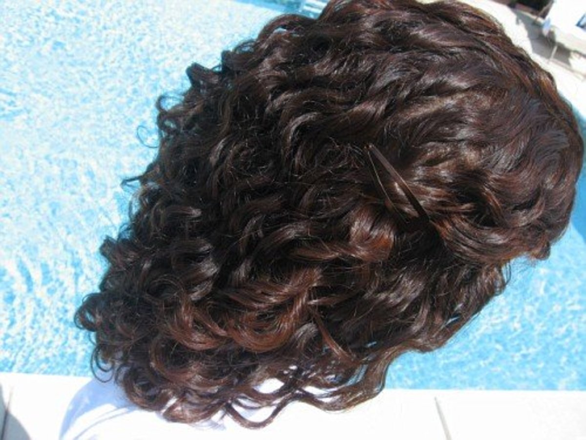 Henna on dark brown hair gives a dark auburn color.