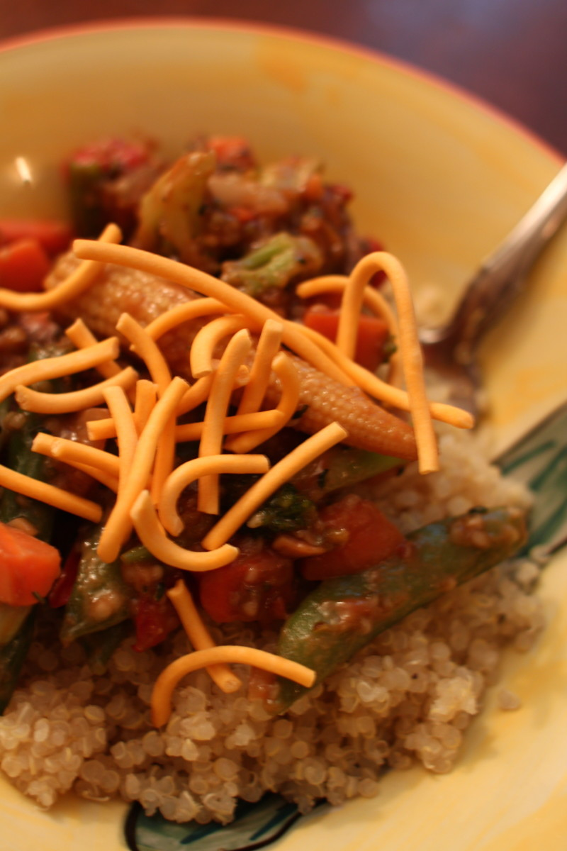 Becoming a veg-head can be as easy as making this delish dish out of some quinoa, frozen veggies, peanut sauce, and chow mein noodles.