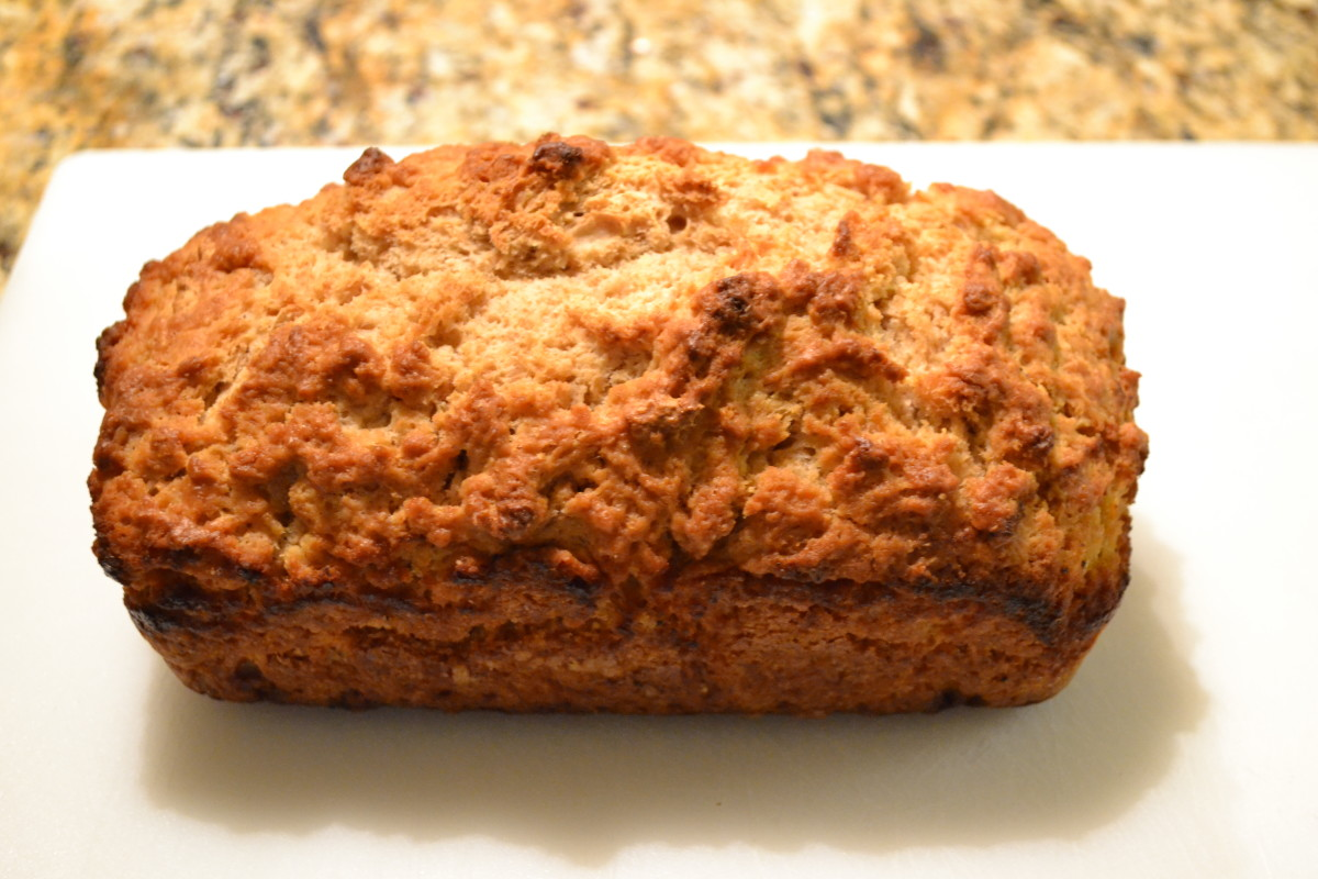 Golden brown beer bread, fresh out of the oven, with a crunchy outer crust, soft inside and lovely golden brown color.
