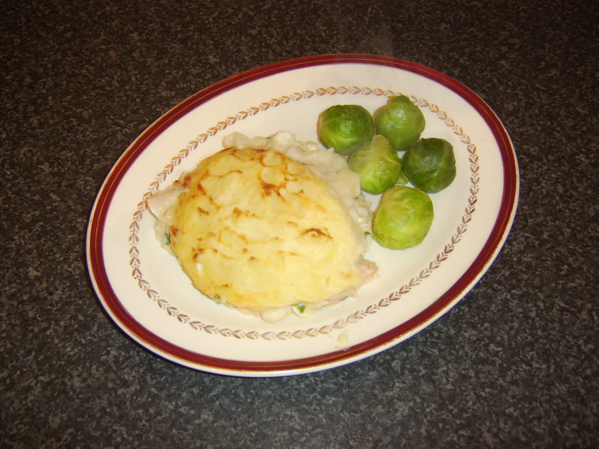 Traditional British fish pie is a meal in itself so is usually served only with one or two small vegetable accompaniments