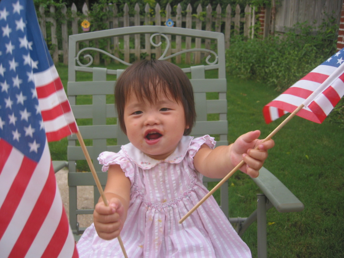 My adopted daughter (who had just become an American citizen) loved waving the American flags on her first 4th of July celebration.