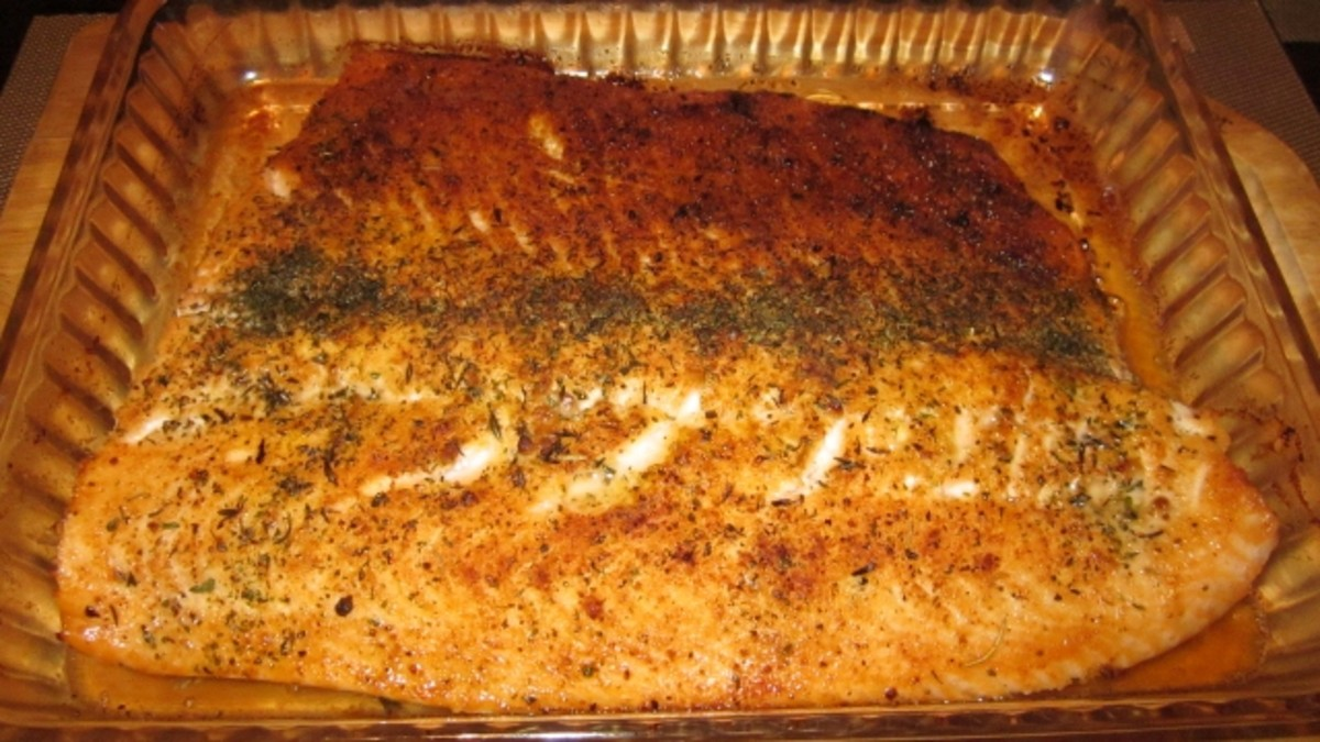 Baked salmon fillet is crusted with several herbs and seasonings to give it a crispy outer crust.