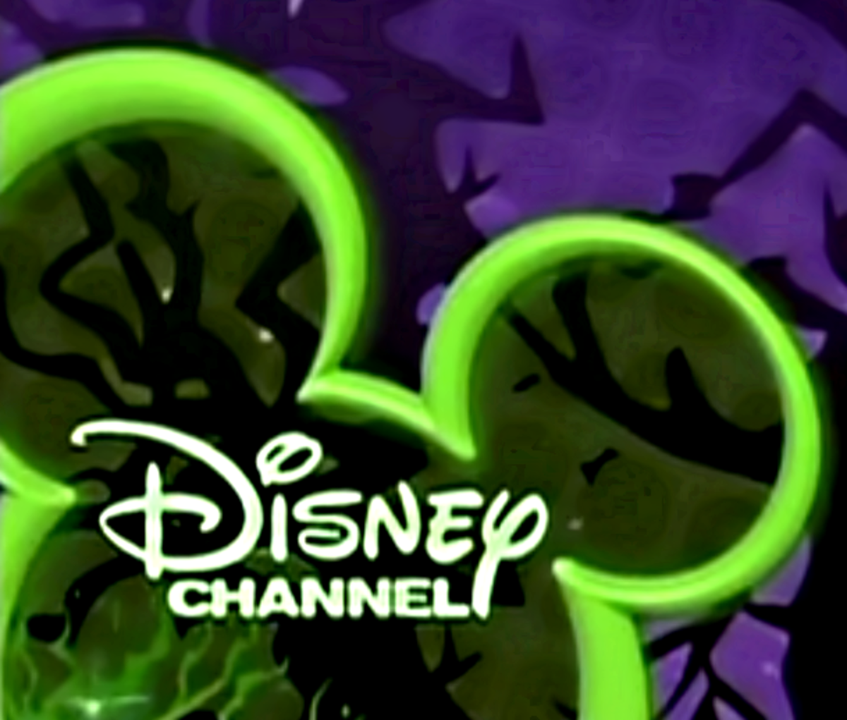 The Disney Channel logo dresses up in green and purple for Halloween fun!