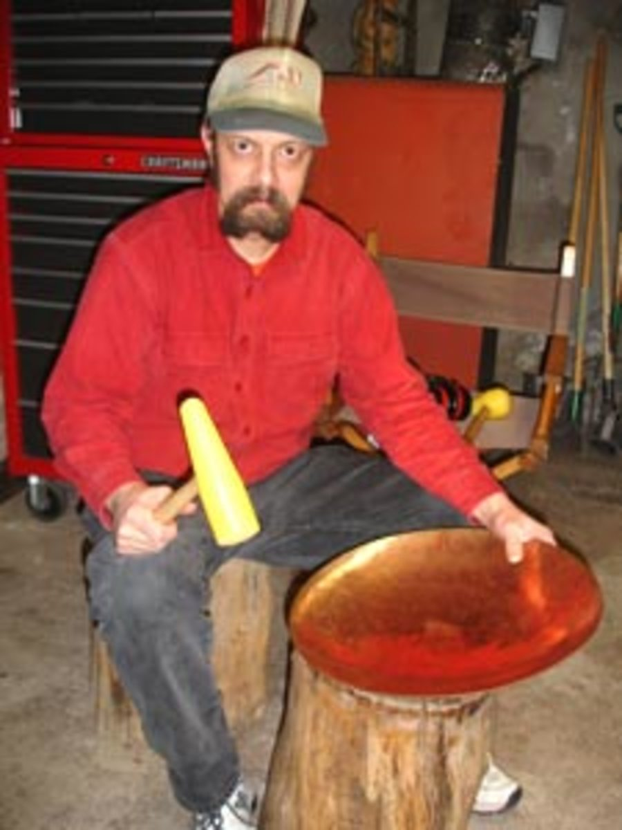 Forming copper bowls from sheet metal by hand