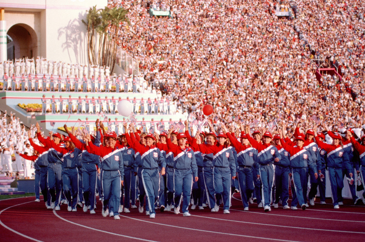The U.S. Olympic Team marches into the LA Coliseum, to the roar of hordes of visitors.