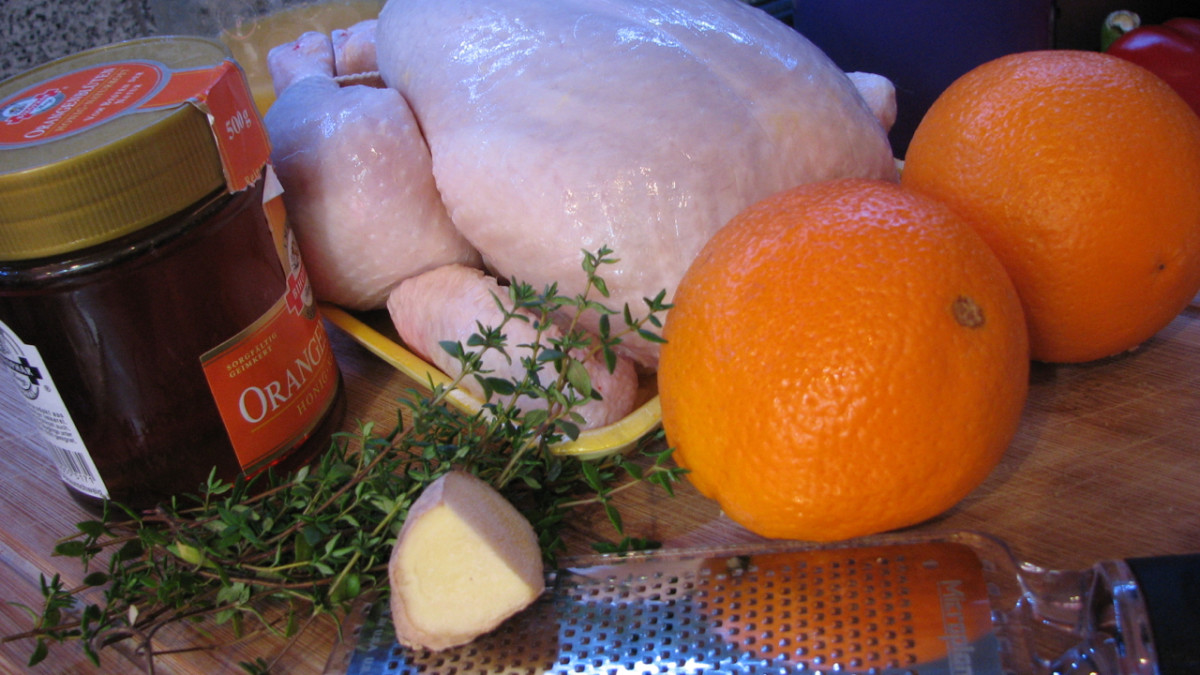 Orange roast chicken ingredients, with orange blossom honey, thyme and ginger.