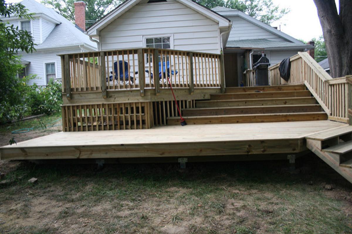 Types of outdoor decking materials dengarden for Exterior decking materials