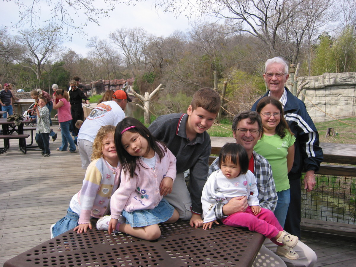 We sought to help delay my father-in-law's symptoms by involving him in family activities like this trip to the zoo.