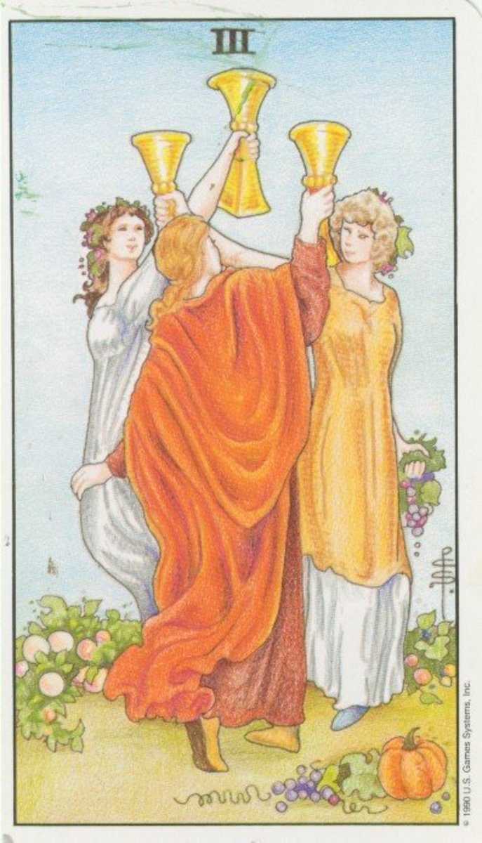 Three of Cups from the Universal Waite tarot.