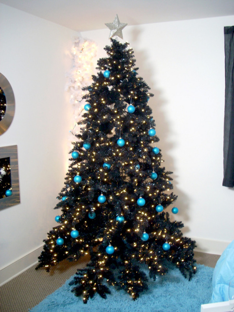 black Christmas tree with blue baubles