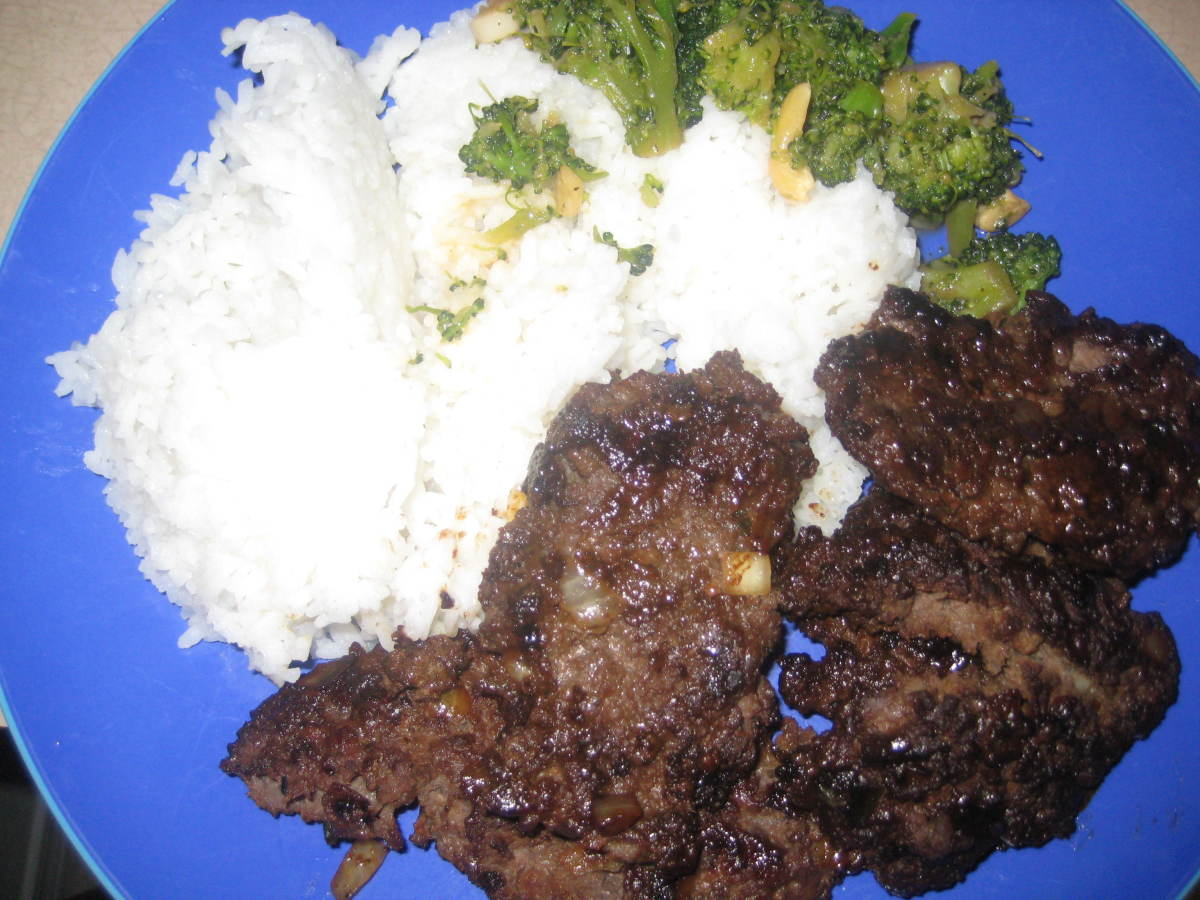 Rice, teri-burger, garlic broccoli... ono.