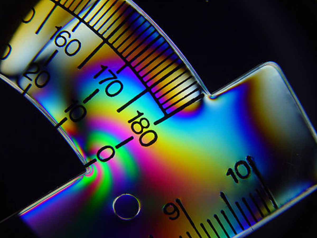 Physics helps us understand the world in which we live. Here, polarized light reveals stress lines on a bent plastic protractor.