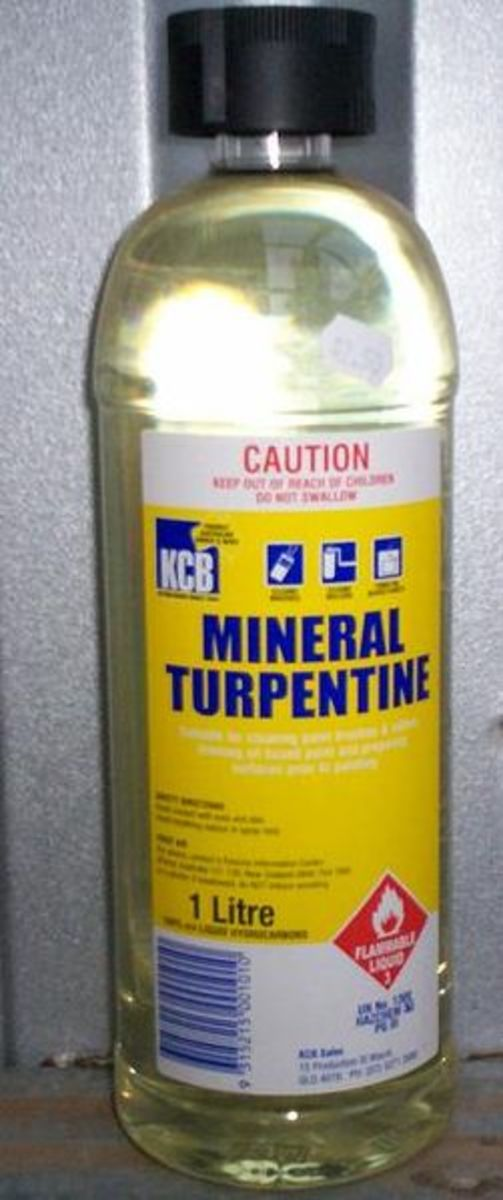 White spirit, paint thinner, or turpentine are ideal for removing wet oil-based paint or wood stains from glass.