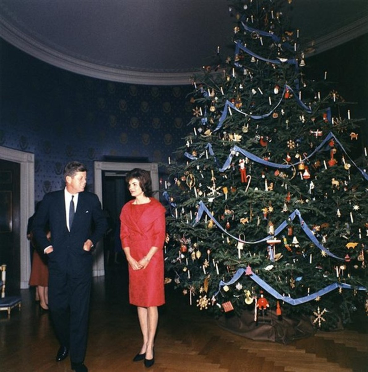 President and Mrs. Kennedy in front of the White  House Christmas Tree, December 13, 1961