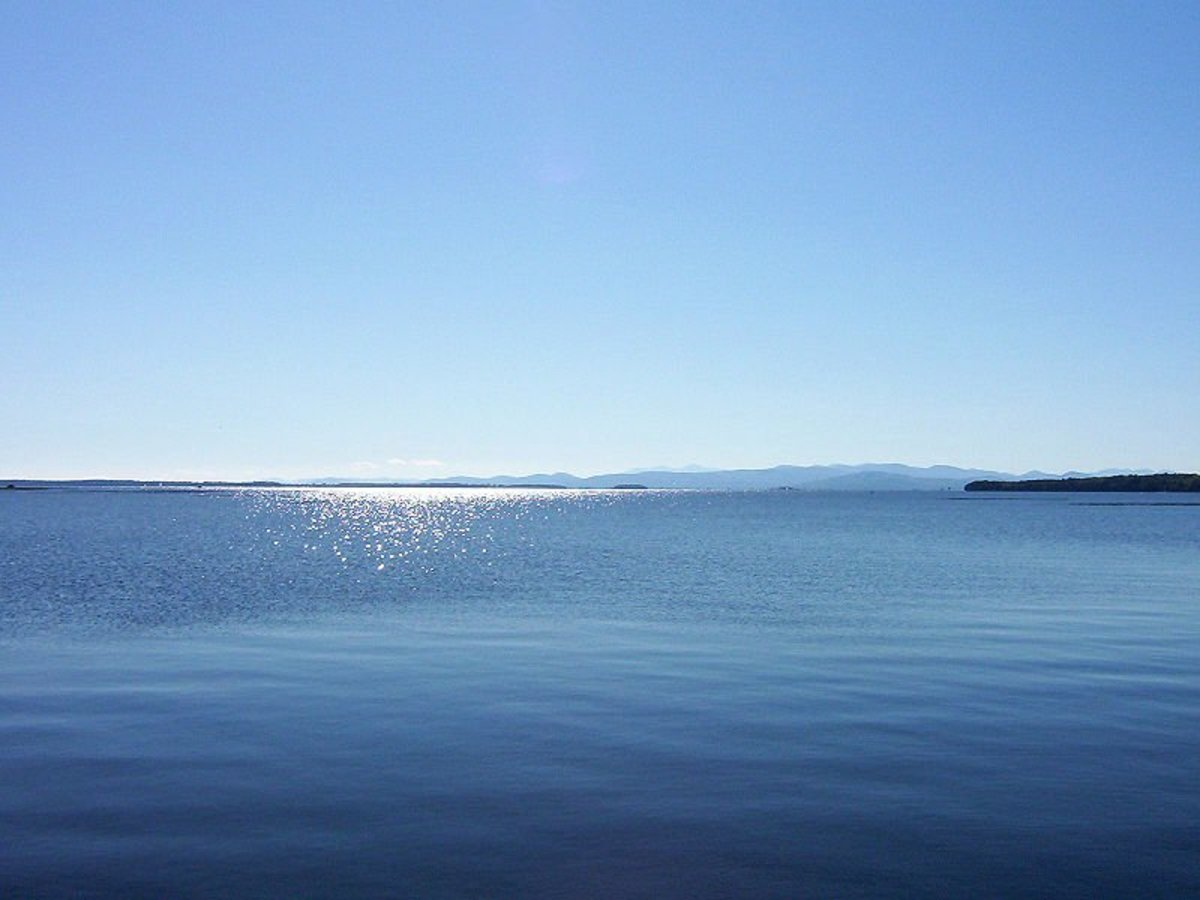 Beautiful Lake Champlain looks peaceful enough, but some say a monster swims beneath its placid waters.
