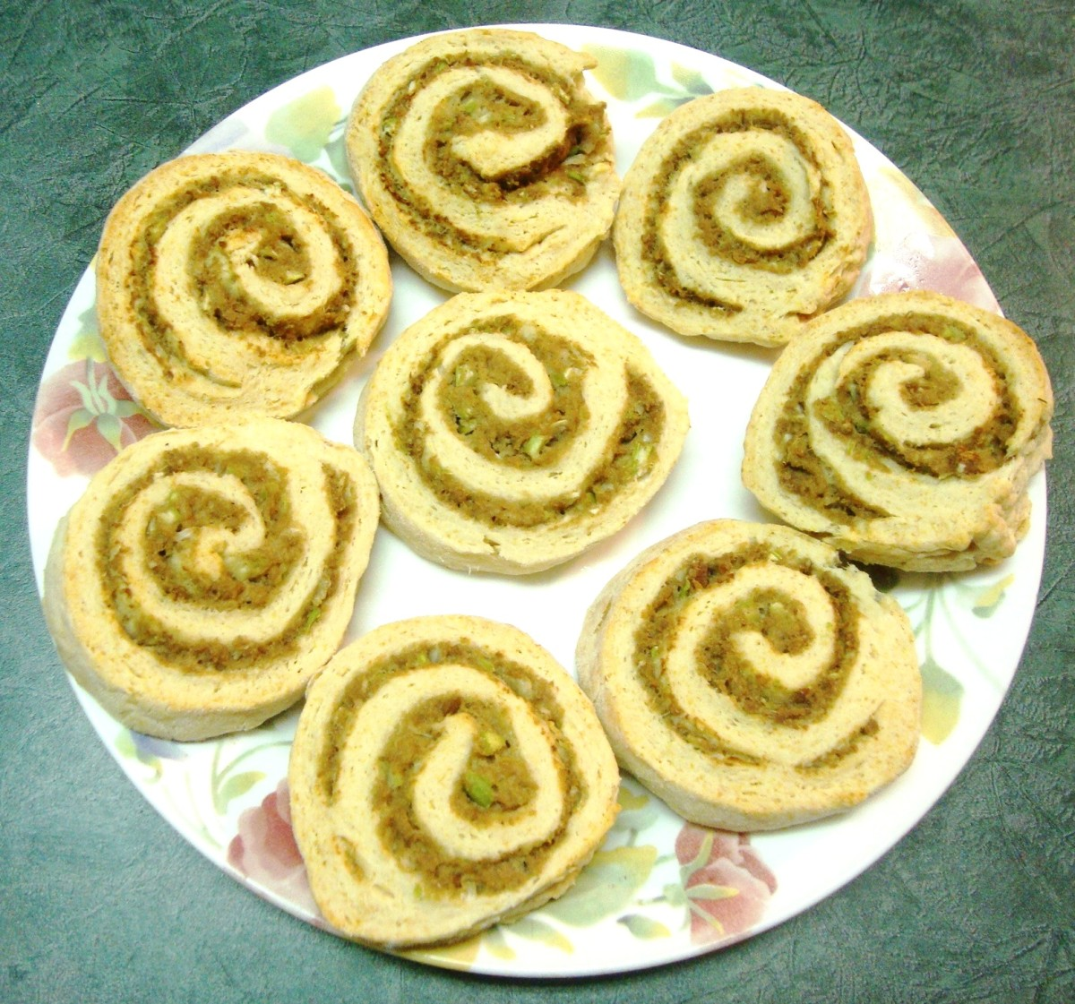 A meat filling peeks out from biscuits spirals.