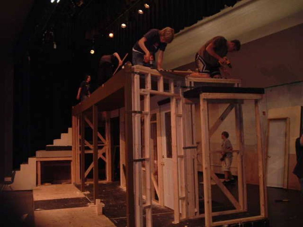 A set construction crew, hard at work to build their set.