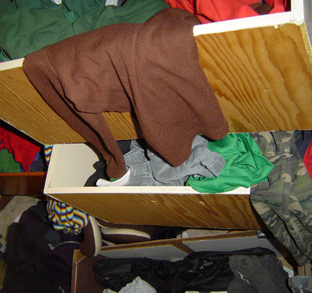 Okay, the closet is a mess, mainly because it has not occurred to our children that all the clothes should fit in the drawers, because they have way too many clothes to fit!