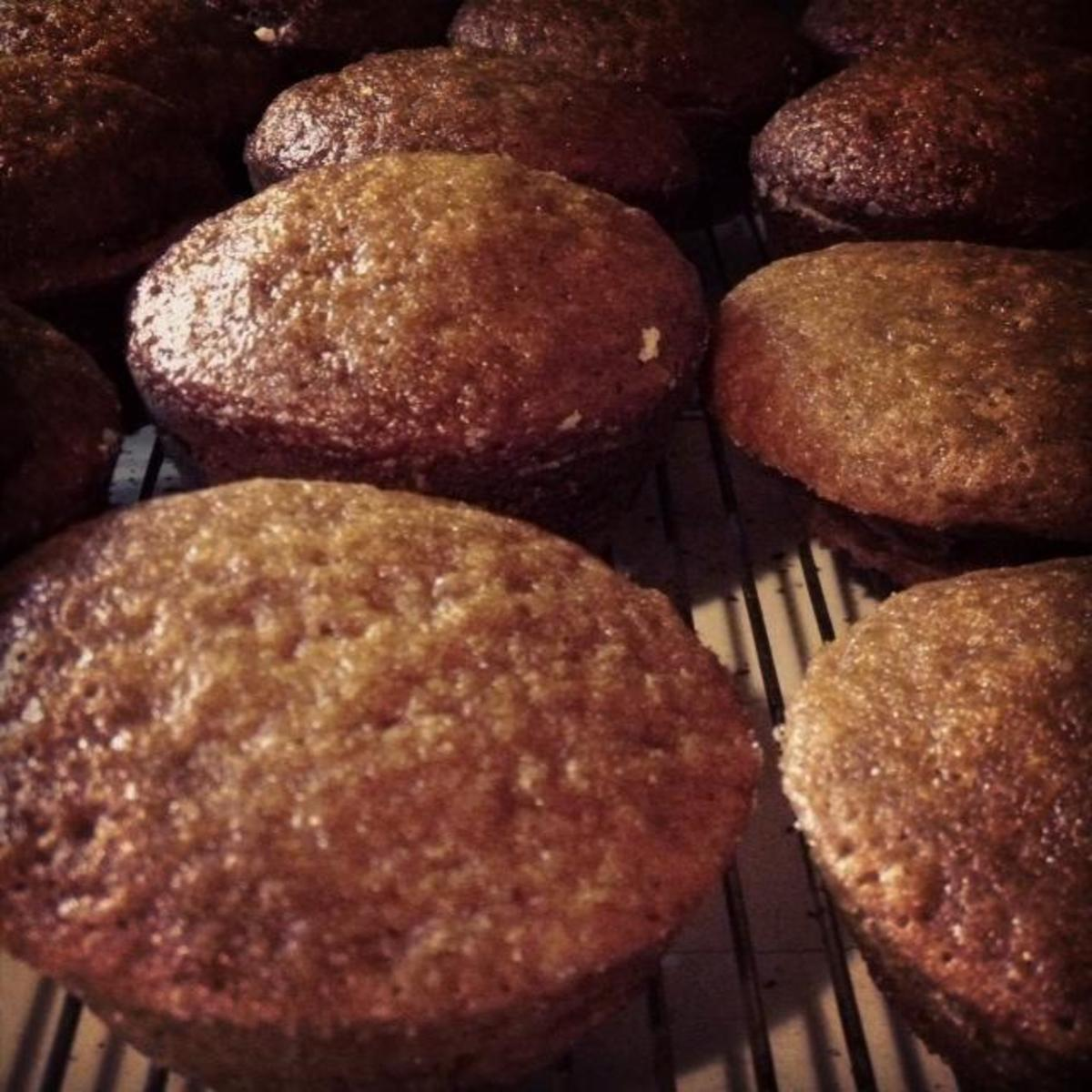 Pumpkin muffins just out of the oven and cooling on the rack.