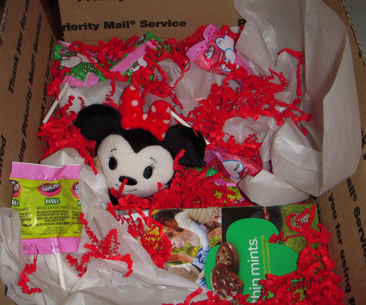 In this Valentine's-Day-themed box, I used hard candy, crinkle paper, and tissue paper for cushioning. This all fit in a USPS medium flat rate box.