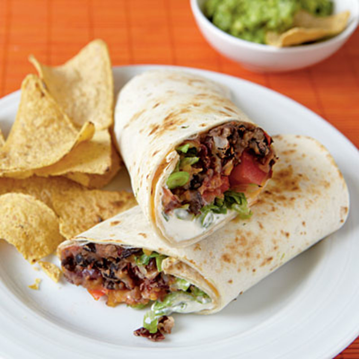 Vegetarian burritos with guacamole.