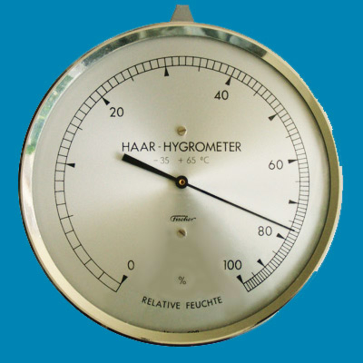 Simple brass wall hygrometer measuring 77% humidity.