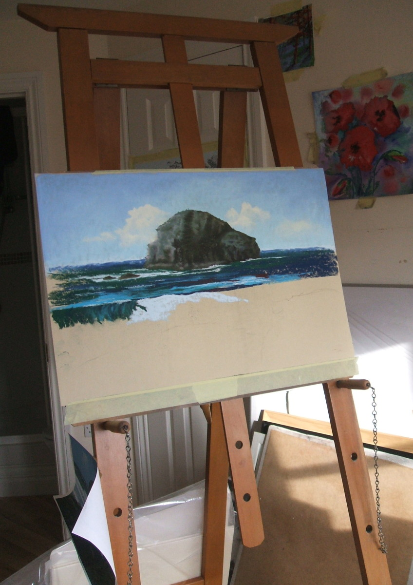My school easel with the half-finished painting of Lifeguards Relaxing At Trebarwith Strand