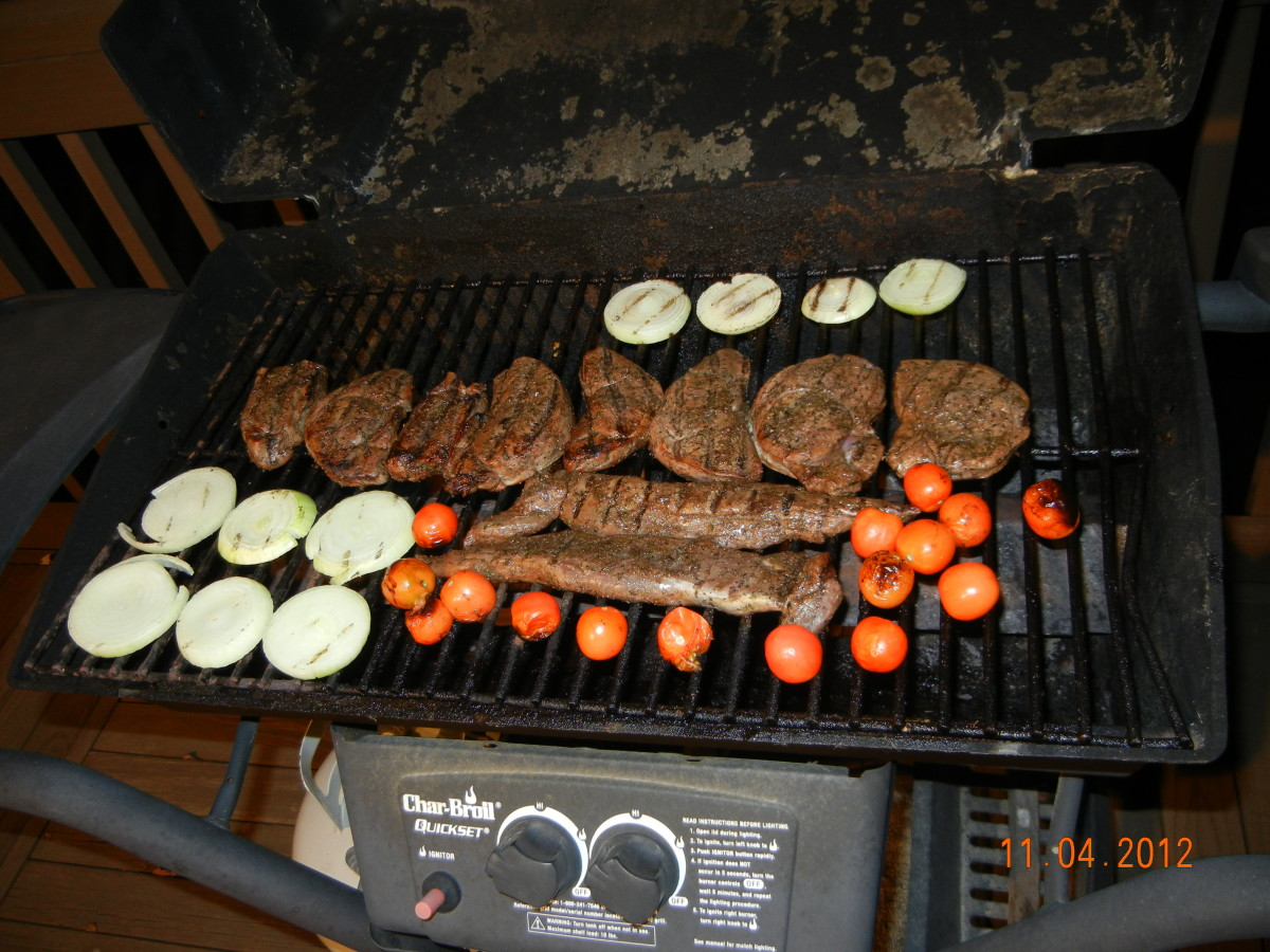 Cooking fresh deer steaks and tenderloin on the grill