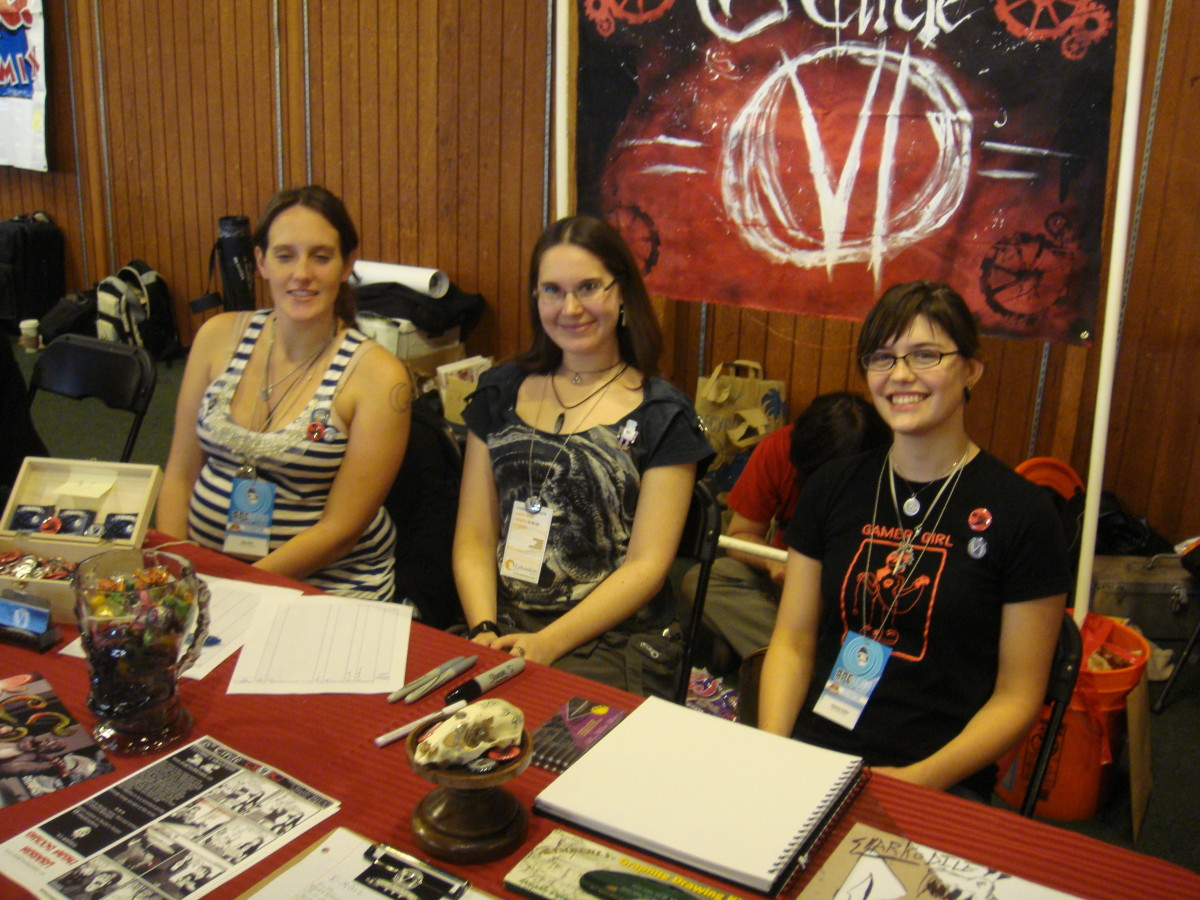 Me (center) and two of my girlfriends as booth babes at a local comic book convention. Events like this are a great way to meet guys!
