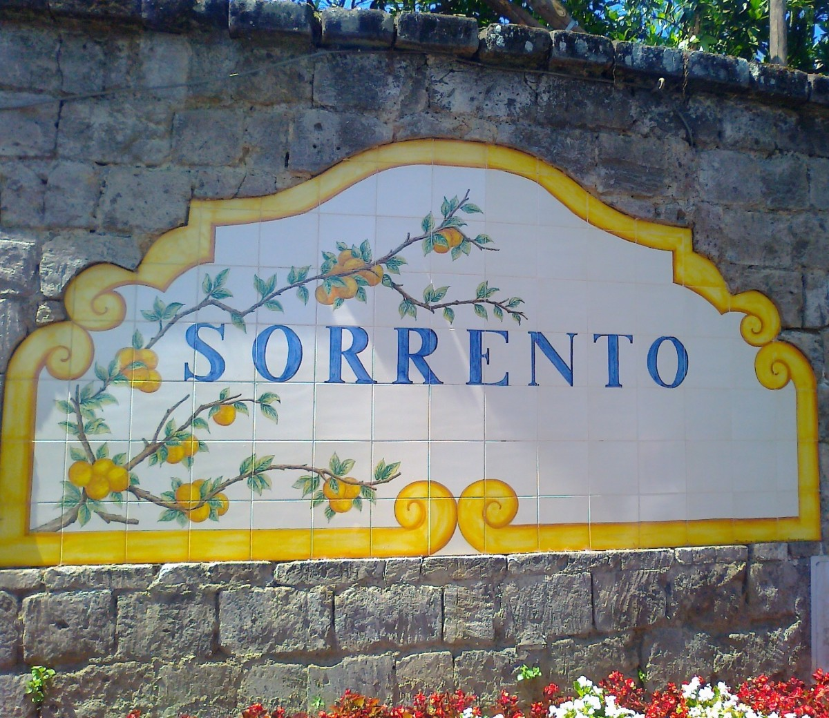 The lemon border hints at one of Sorrento's most notable achievements, Limoncello