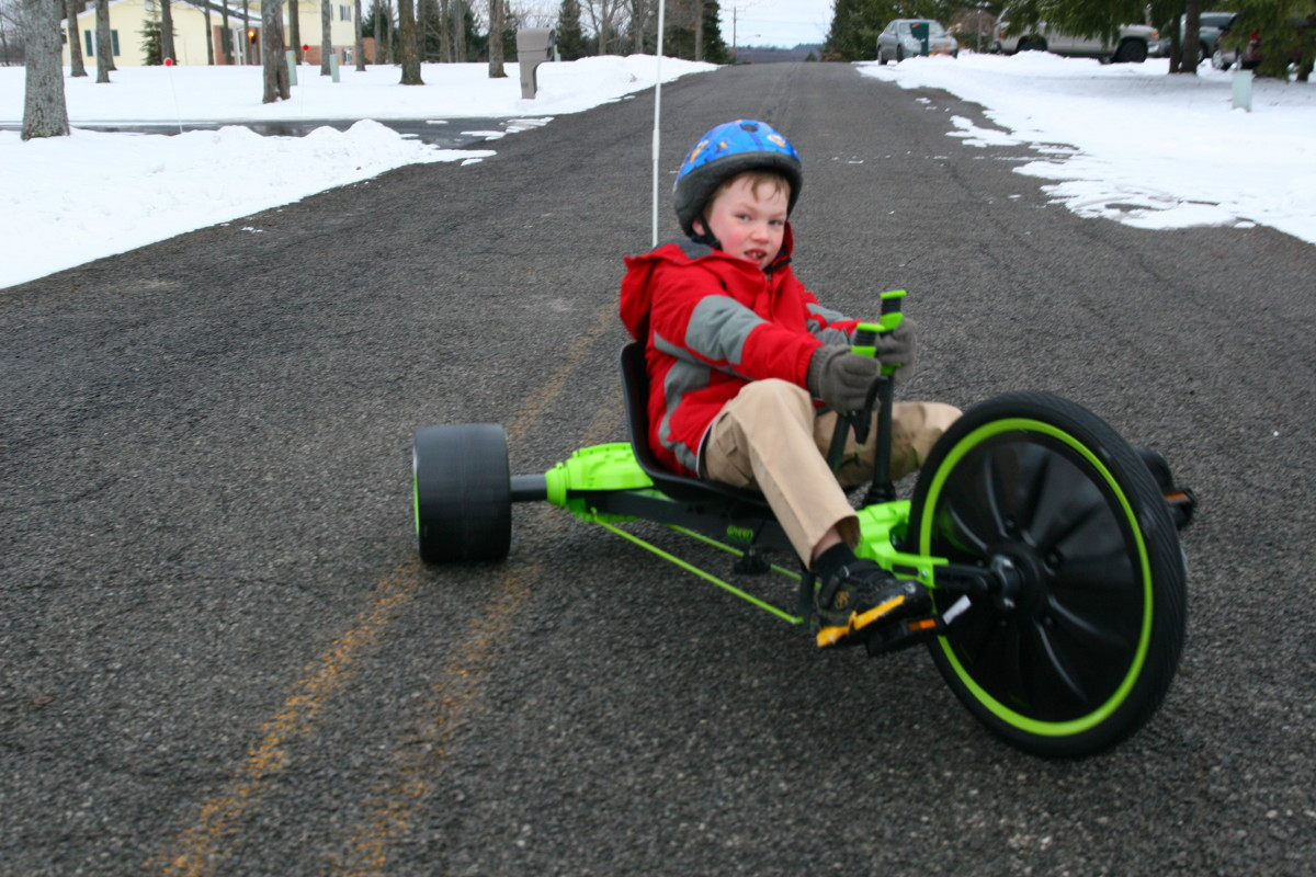 The author's tall 7-year-old son rides his new Huffy Green Machine on Christmas Day.