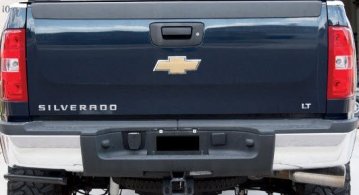 The rear of a Chevy Truck has the tailgate, trailer wires, and spare tire access.