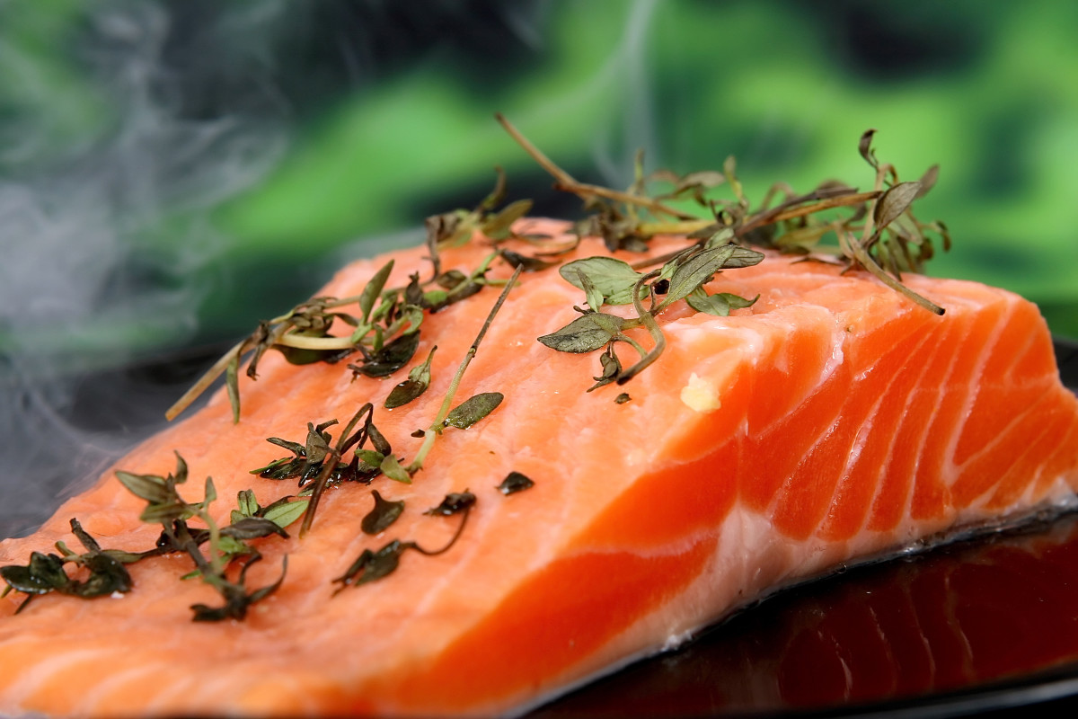 Wild salmon is a good source of DHA and EPA, but it isn't an acceptable food for vegans or vegetarians.