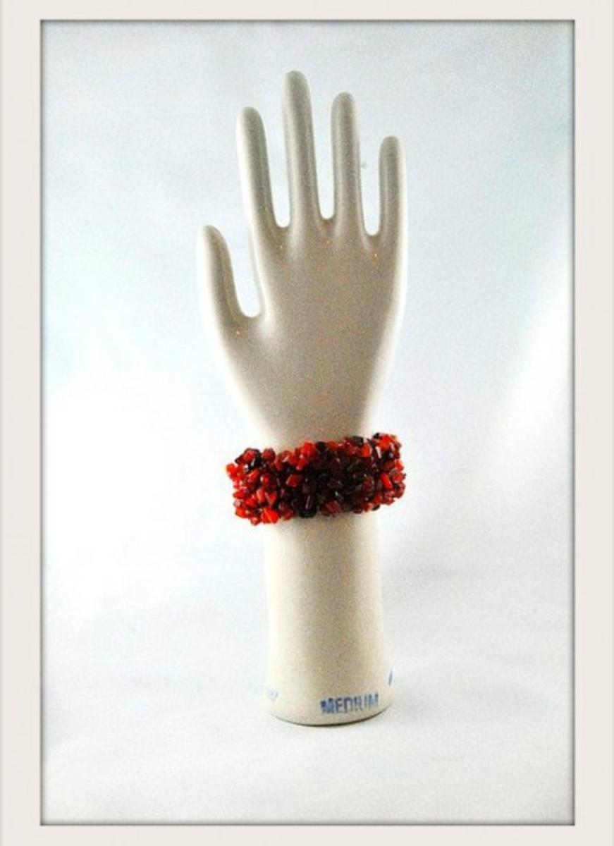 Let me give you a hand selling on Etsy.  Glove Mold: RetroChalet Bracelet: TreasureTrunk Designs.