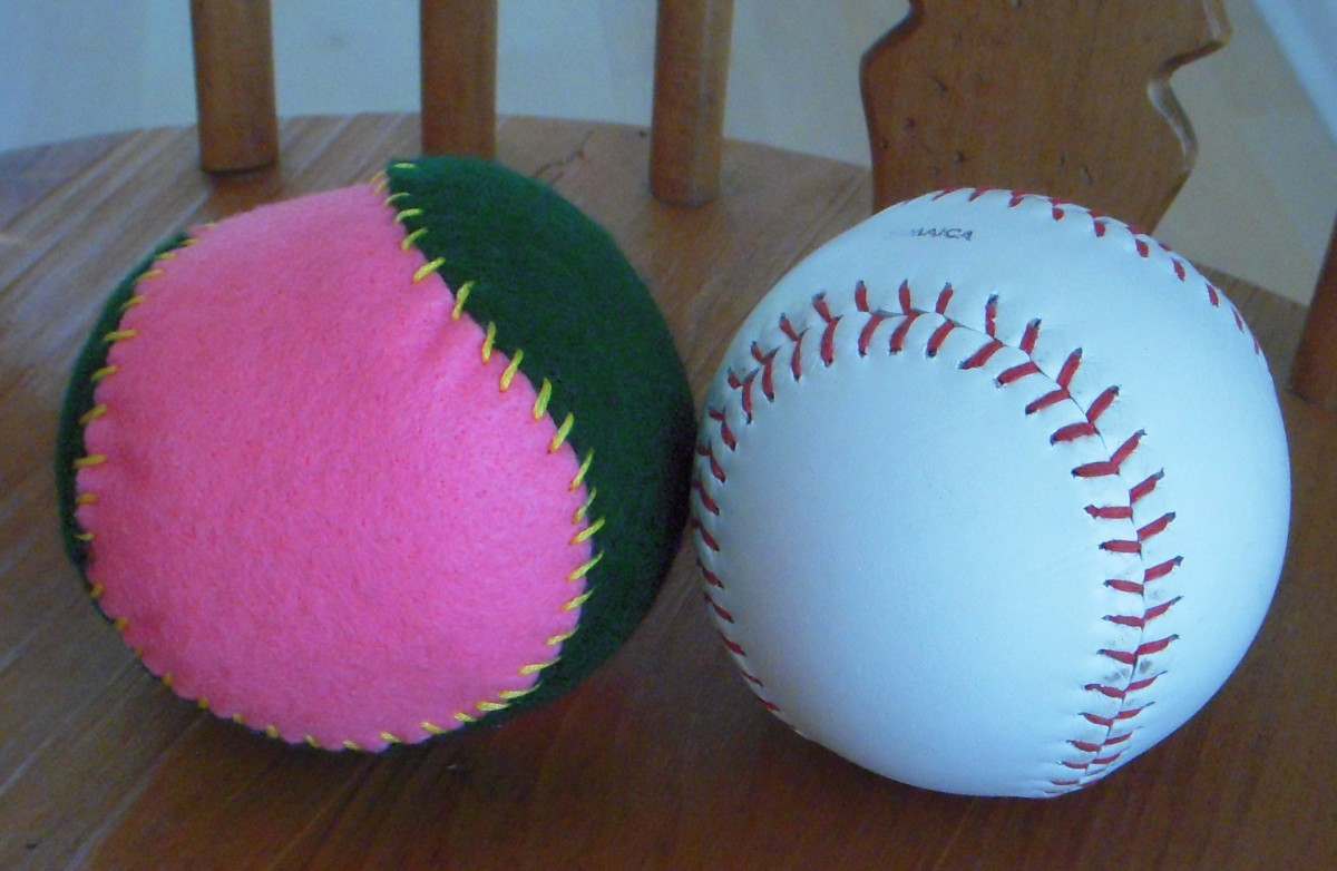 Felt ball next to a baseball.