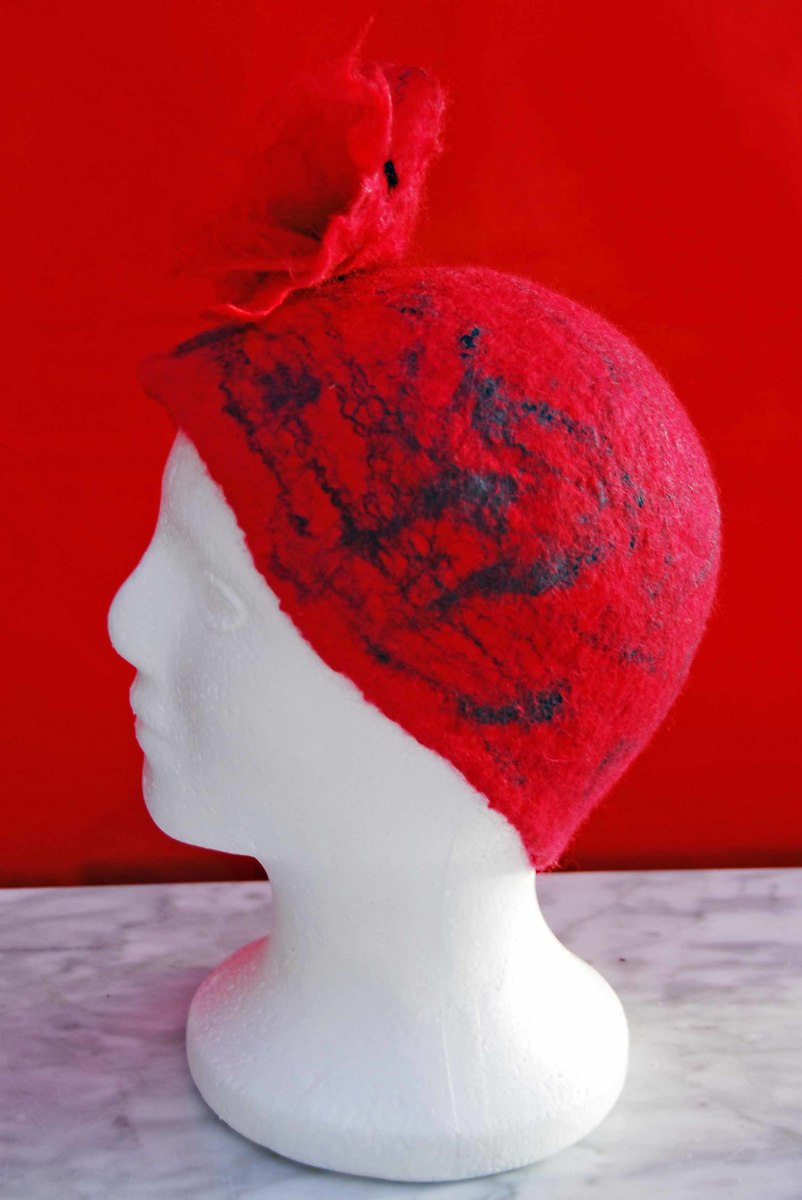 Wet felted hat with a felt flower