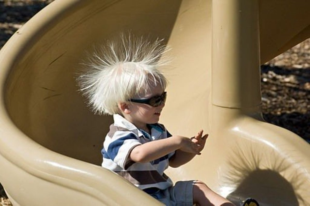 Static electricity in this little boy's hair makes a fun picture, but it's not so much fun having static electricity cause your clothes to stick to you!