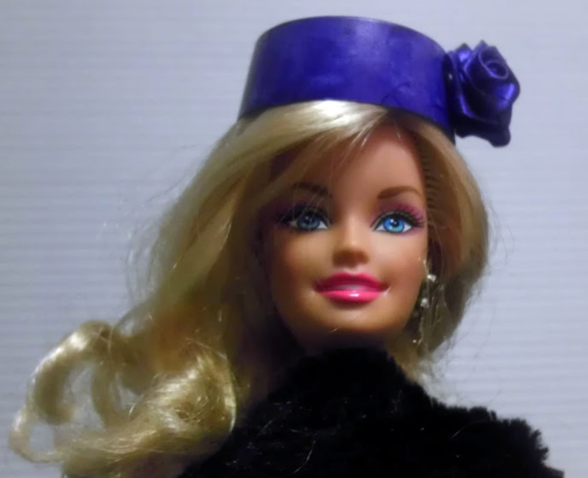 Barbie looks super glamorous in a navy hat made of a discarded K-cup.