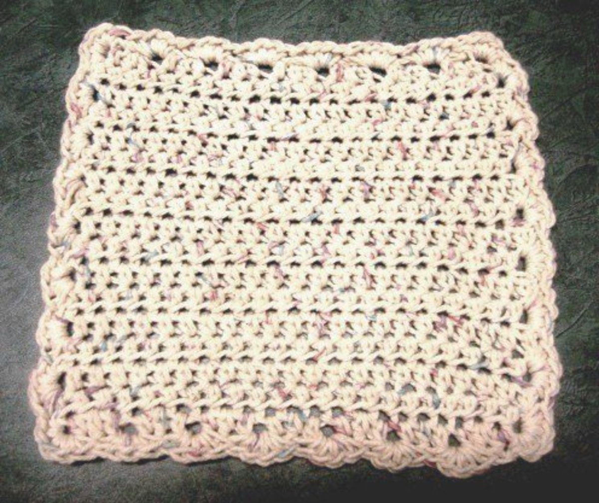 Adding a scalloped edge pretties up this practical dishcloth.