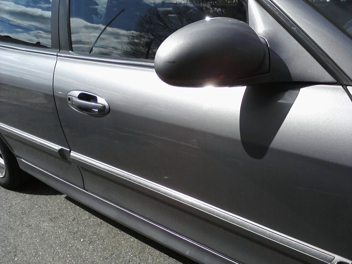 The Invention and Evolution of the Automobile Door