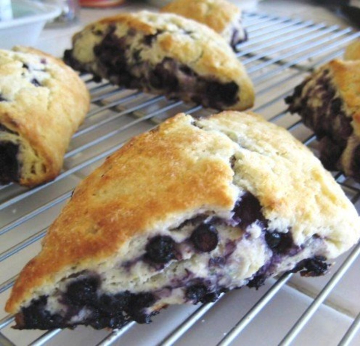 Blueberry scones are the perfect breakfast treat. Stuffed full of blueberries, these biscuits offer color and flavor.