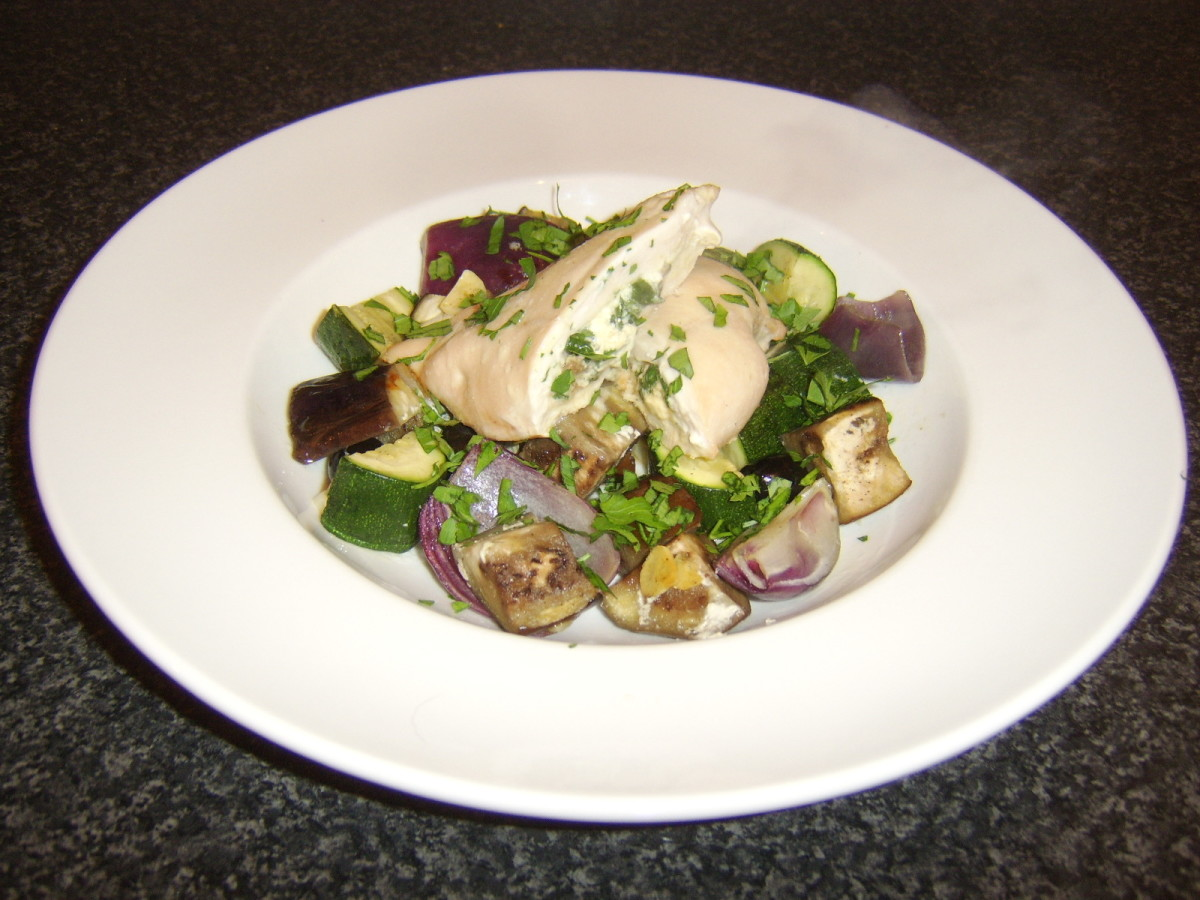 Chicken breast stuffed with feta cheese, porcini mushrooms, and spinach, served with roasted Mediterranean vegetables