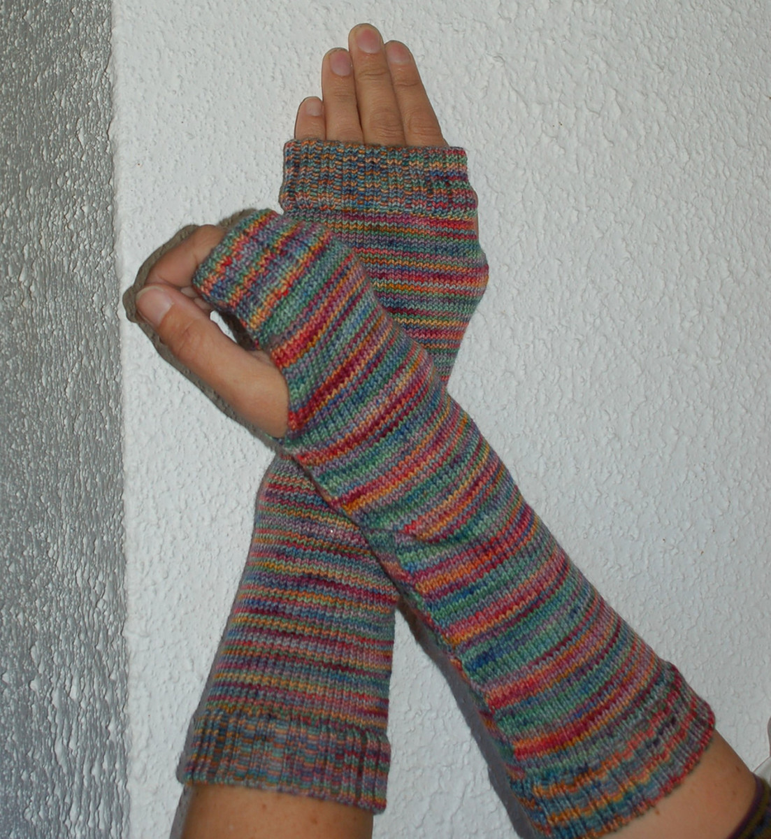 Arm warmers with fingerless gloves.