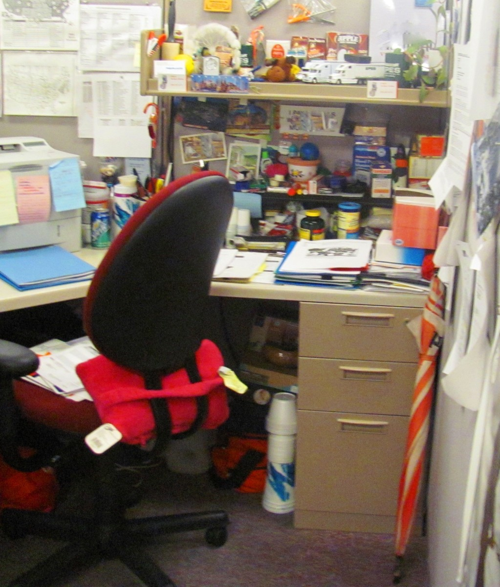 """Many workers display collections and knick-knacks in their cubicles in an attempt to make their office spaces seem like a """"home away from home."""""""