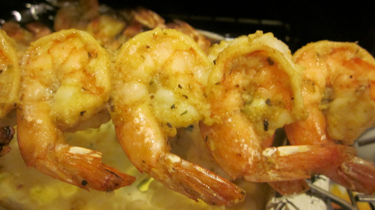 Easy shrimp on skewers are seasoned, baked and lightly broiled for a tasty seafood meal.