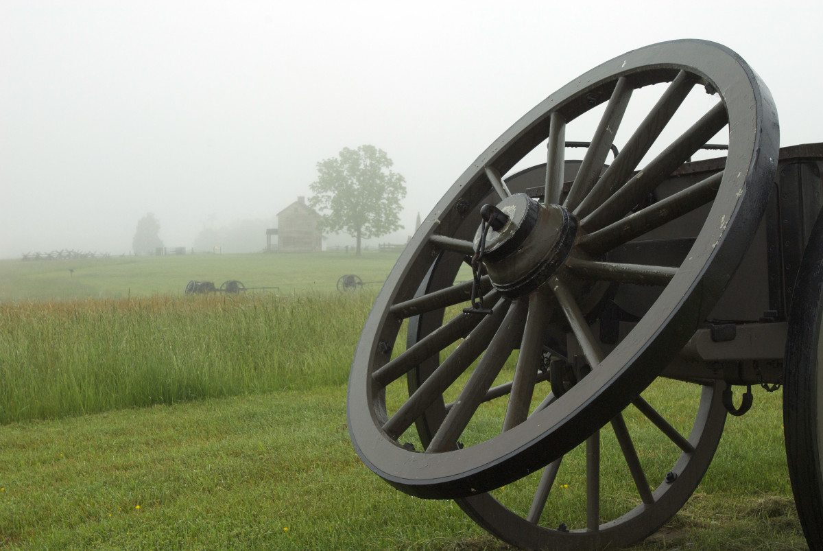Near the main entrance are a series of cannons and wagons.  The old house in the background is an important feature in the movie they play inside.  If you look closely, you can see it in the foggy distance.