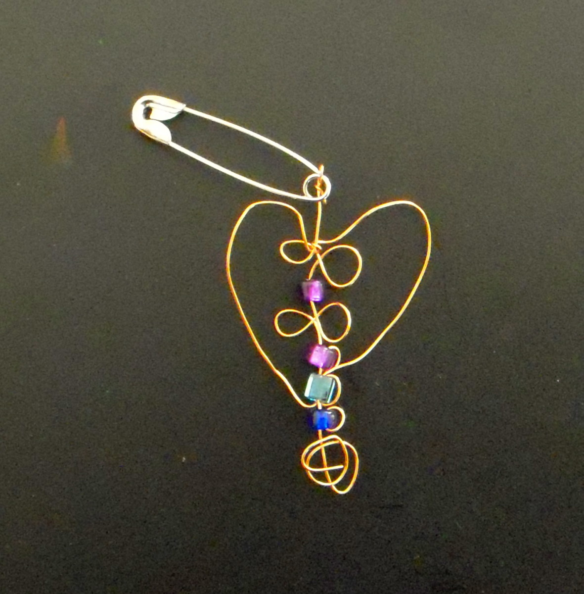 SWAP made from thin copper craft wire, a few beads and a safety pin.