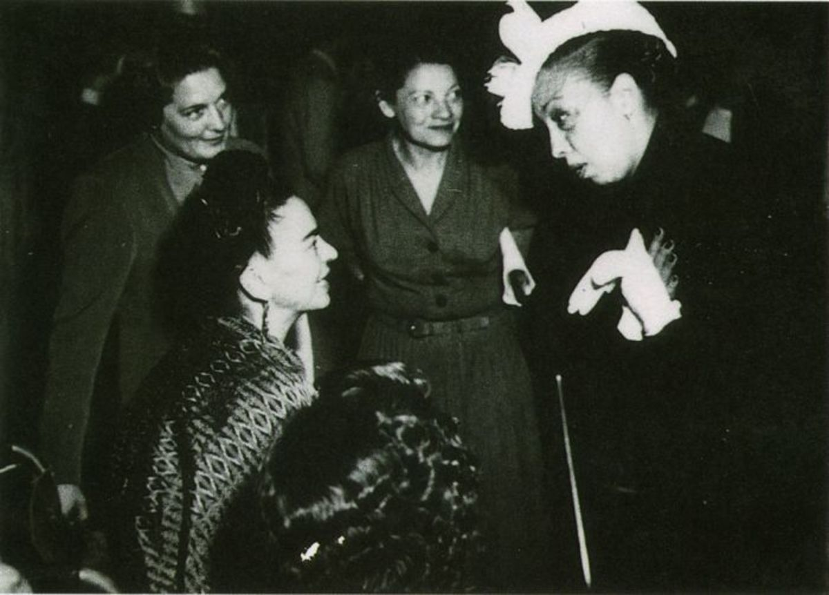 Frida Kahlo, artist, and Josephine Baker, entertainer, talking to each other.