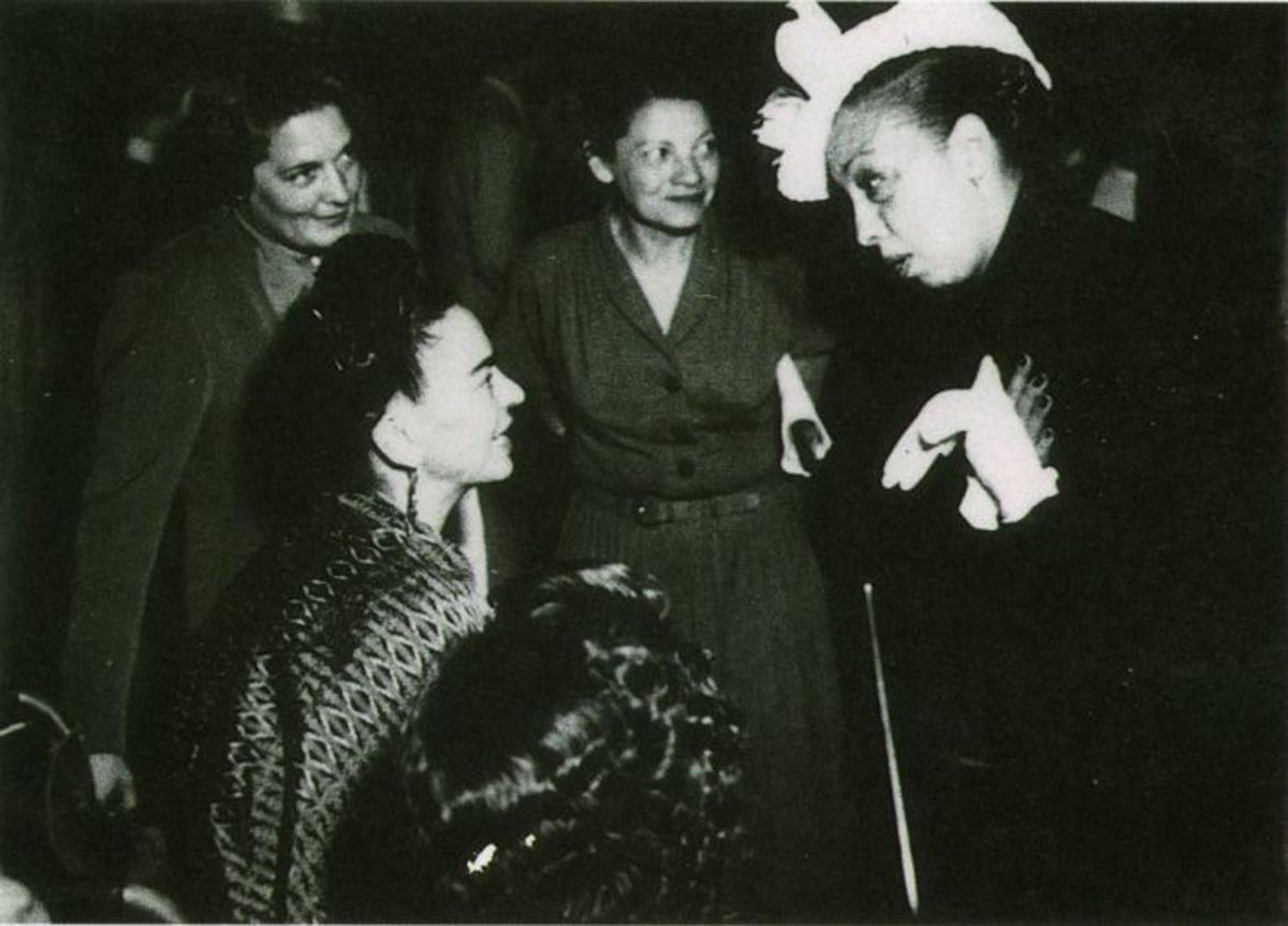 Frida Kahlo, artist, and Josephine Baker, entertainer, talking to each other.